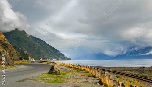 Alaska road along water at Turnagain Arm with clouds Canvas Print