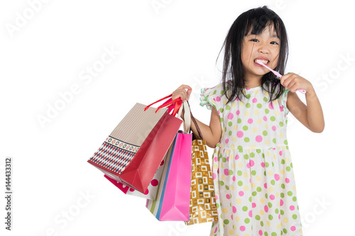 Asian chinese little girl with shopping bags Wallpaper Mural