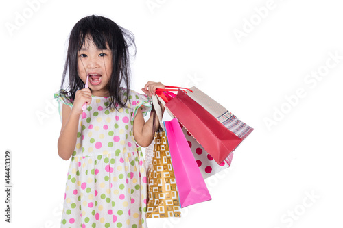 Photo Asian chinese little girl with shopping bags
