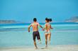 young happy couple running on the beach. Balos beach, Crete, Greece.