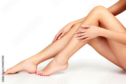 Woman legs on white background, isolated Fototapete