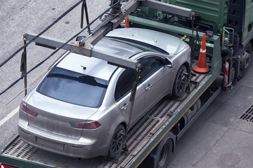 Car on platform of tow truck