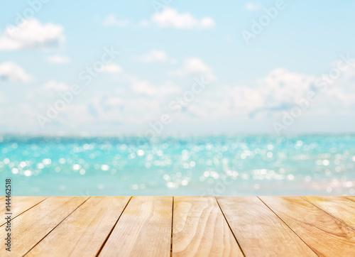 Valokuvatapetti Wooden table top on blue sea