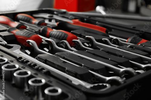 Fotografía  Box with special tools in car repair shop, closeup