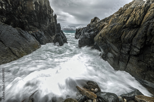 Canvas Prints Dragons Movement of water on the shores of cold Norwegian Sea at evening time. Lofoten islands. Beautiful Norway landscape.
