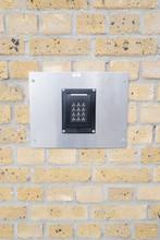 Keypad On A Brick Wall