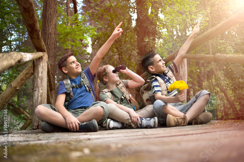 happy childs in green forest playing,concept of kids vacations and travel