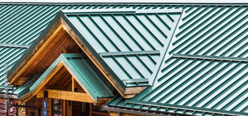Stampa su Tela Green Metal Roof on Wood Building