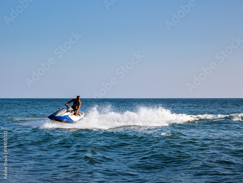 Recess Fitting Water Motor sports Silhouette of man on jetski at sea
