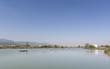 Calm lake with fishing boats. Fresh water lagoon in Estany de cullera. Valencia, Spain