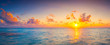 Beautiful colorful sunrise at the sea with dramatic clouds and sun shining in vintage style panorama