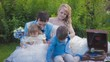 Bride and Groom Have Picnic With Their Children. Slow Motion