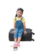 Asian little girl sitting on her luggage with happiness isolated on white background with clipping path