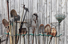 Old Gardening Tools On A Wooden Background