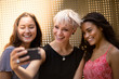 Female friends posing for a selfie