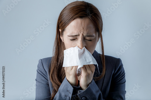 young woman blowing her nose. allergic rhinitis. hay fever. Canvas Print