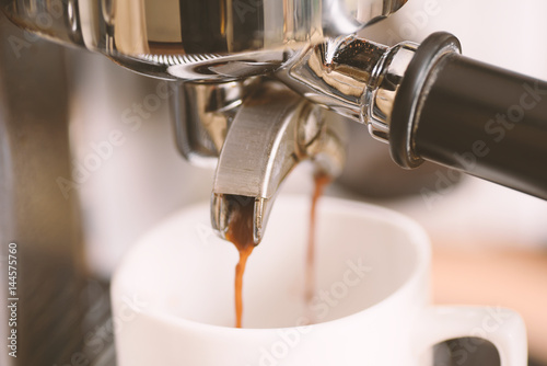 Fototapety, obrazy: Coffee flowing into a cup from espresso machine