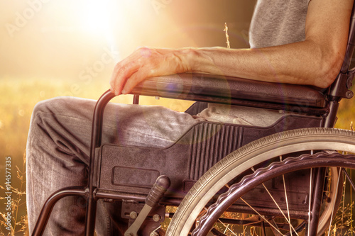 Valokuva  Closeup of Man on Wheelchair Enjoying Nature