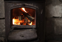 Fire Burning In Small Black Iron Stove