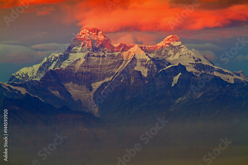 First light on Nanddevi peak in the Himalayas Poster