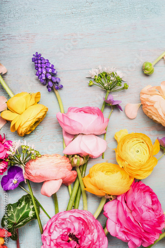 Fotografía  Variety of colorful summer flowers for greeting bouquet  on blue vintage shabby