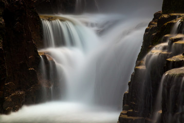 Obraz Small waterfall in a crevice. Norway