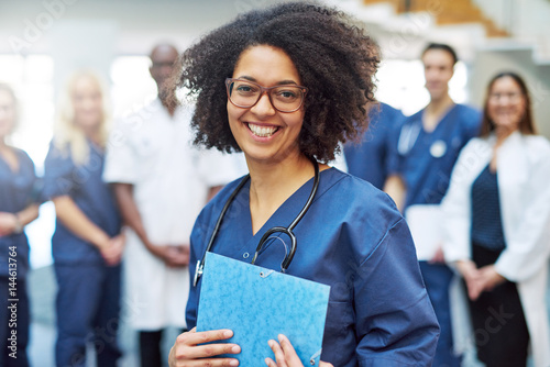 Obraz Cheerful African American medical worker in hospital - fototapety do salonu