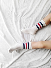 Close-up Of A Boy's Feet And Socks