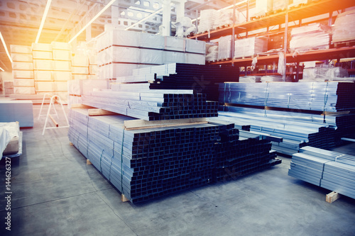 Foto Steel, Shelf with structural materials on the shelves in the building warehouse