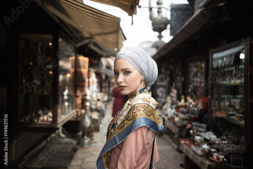 Portrait of young woman standing in market