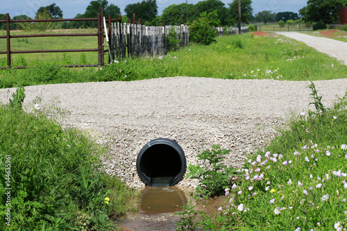 Fényképezés  Drainage pipe: New culvert under small country side gravel road