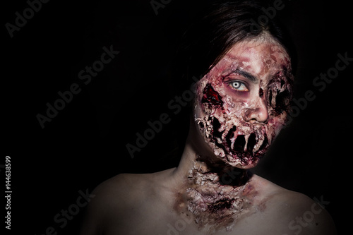 horrible scary zombie girl on black background with copyspace Fototapet