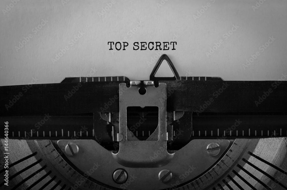 Fototapeta Text Top Secret typed on retro typewriter
