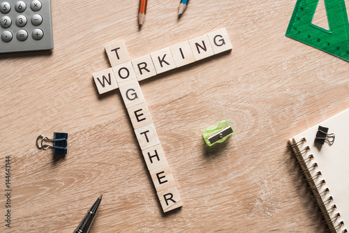 Fotografie, Obraz  Working together words collected of game cubes on wooden surface