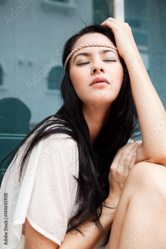 Photo  Girl sitting near the window