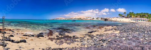 Staande foto Strand View to Costa Calma sandy beach with vulcanic mountains in the background on Fuerteventura island, Canary Islands, Spain.