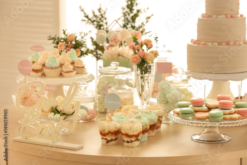 Poster Confiserie Table with sweets prepared for party