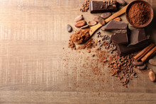 Composition With Cocoa Powder And Pieces Of Chocolate On Wooden Background