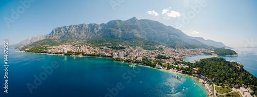 Fotobehang Mediterraans Europa Aerial Photo drone Makarska, Croatia. Coast city, sea and mountains