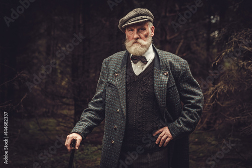 Senior man wearing traditional english clothes outdoors