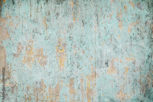 Fotografering  Weathered, faded and peeled off turquoise concrete wall texture background with vignetting