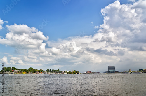 Wonderful view on a bay and cloudy sky in Amsterdam . Canvas Print