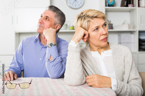 Man and woman 50-54 years old are offended at each other Canvas-taulu