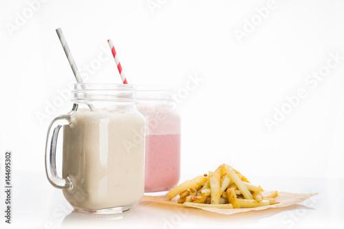 Foto op Plexiglas Milkshake Strawberry and banana milkshakes on the white background