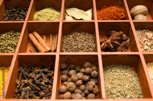 Foto op Canvas Kruiden various kind of spices in old wooden box in the rustic style