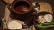 Traditional Russian food. Restraint table macro meal. Borsch in pot. Quality gimbal movement.