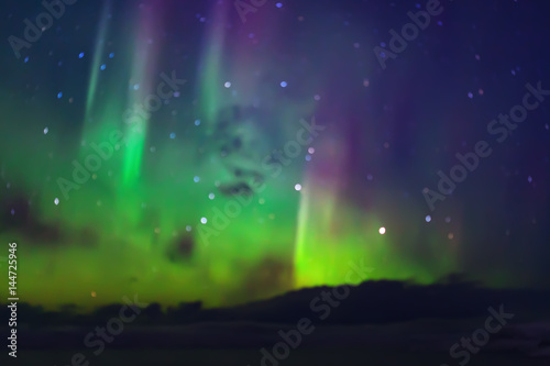 Photo sur Toile Aurore polaire Northern lights. Aurora borealis nature landscape at night
