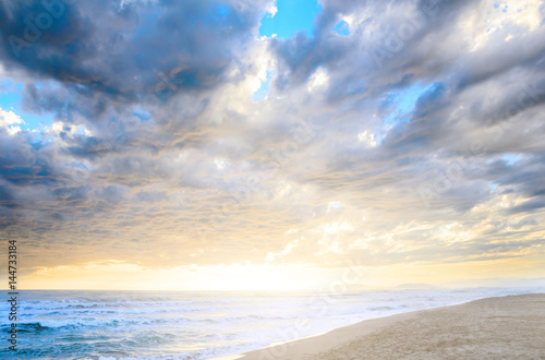 Foto op Canvas UFO Dramatic cloudy sunset at seaside