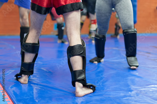 Tuinposter Vechtsport protective leg gear for mixed martial arts