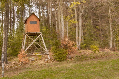 Fotobehang Jacht Hunting hide in the forest. Hunting stash. The wooden tower.